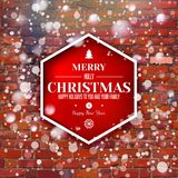 Brick wall with red Xmas typography label Royalty Free Stock Photography