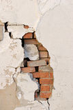 Brick wall revealed. Crumbling wall with revealed brick work stock photo