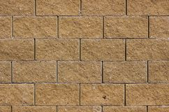 Brick wall. From rough light brown colored brick Stock Photo