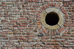 Brick wall and round hole Royalty Free Stock Photo