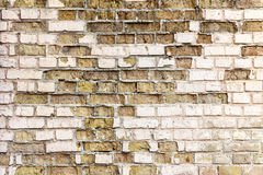 Brick wall. The ruined brick wall isolated Stock Images