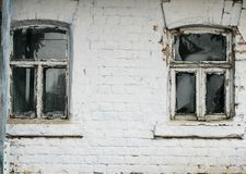 Free Brick Wall Rural House With Two Small Old Rickety Windows Stock Photo - 107676220