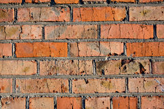 Brick wall. Rusted old brick wall red and orange stock image