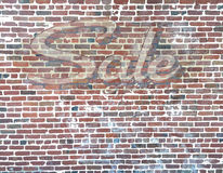Brick Wall with Sale Ghost Sign. Old Brick Wall with Sale Ghost Sign Stock Photo