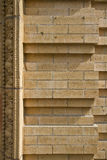 Brick Wall with Scroll Design. On Historic Building Stock Photo