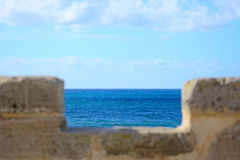 Brick wall by the sea Royalty Free Stock Images
