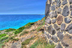 Brick wall by the shore in Sardinia Royalty Free Stock Image