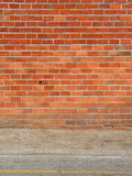 Brick wall and sidewalk Royalty Free Stock Photos