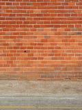 Brick wall and sidewalk