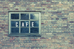 Brick Wall with Sign Cafe Stock Images