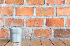 Brick wall with silver bucket Royalty Free Stock Photos