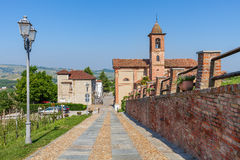 Brick wall and small church in Italy. Royalty Free Stock Photography