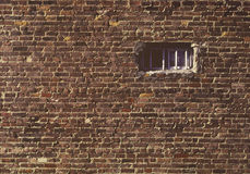Brick wall with small window Royalty Free Stock Photography
