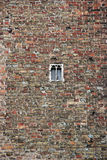Brick wall with small window. Brugge stock photography