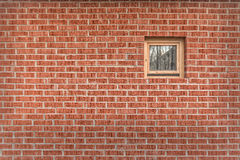Brick wall with a small window. Small window on a wall from a bricklaying Stock Photos