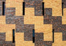 Brick wall with small windows Royalty Free Stock Image