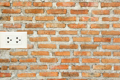 Brick wall and socket Royalty Free Stock Photos