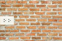 Brick wall and socket Royalty Free Stock Photos