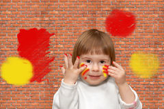 Brick wall. The soiled child Stock Photo