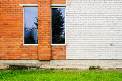 Brick wall with some windows. Red and white brick wall with some windows Royalty Free Stock Images