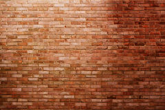 Brick wall in spotlight stock photography