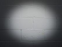 Brick wall with spotlight. Spotlit white brick wall for background Royalty Free Stock Photos