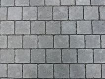 Brick wall stone road Gray background black royalty free stock photo