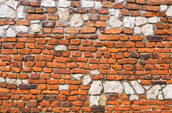 Brick wall with stones Stock Photography