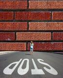 Brick wall and stop sign Stock Photos