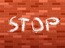 Brick wall and stop text Stock Photo