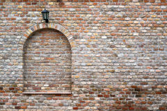 Brick wall and street lantern Stock Photo