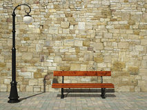 Brick wall with street light and bench Stock Photo