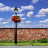 Brick Wall with Street Light Stock Images