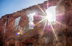 Brick Wall with Sunlight. Clear Blue Sky in Background. Old Ruins in LIthuania. Stock Photos