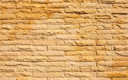 Brick wall. In sunny day light background texture Stock Images