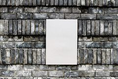 Aluminium plate on the rock wall Stock Photography
