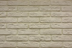 Brick wall texture background in the light of ancient cream beige brown. Brick wall texture background in the light of ancient natural cream beige brown Royalty Free Stock Photo