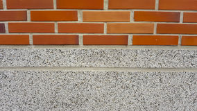 Brick wall texture background. And small gravel stone Stock Photography
