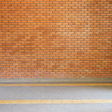 Brick wall texture background and small gravel stone Stock Image
