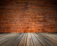 Brick wall texture background and wooden floor. Royalty Free Stock Photography