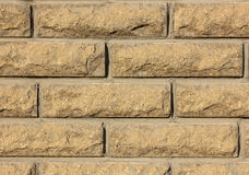 Brick wall texture. Brown rough Stock Photography