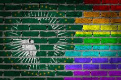 Brick wall texture - Flag of African Union with rainbow flag. Very old dark red brick wall texture - Flag of African Union with rainbow flag royalty free stock image
