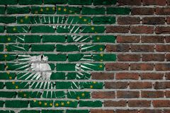 Brick wall texture - Flag of African Union. Very old dark red brick wall texture - Flag of African Union royalty free stock images