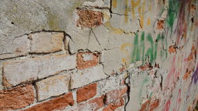 Brick wall texture with grafitti Stock Images