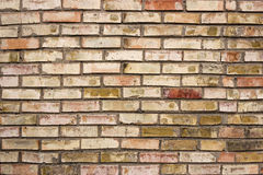 Brick wall. The texture of the brick wall of multicolored bricks Stock Photos