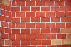 Brick wall. Texture red brick wall in street Stock Photography