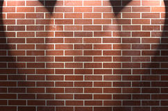 Brick Wall with Three Spotlights. Red brick wall with three spotlights on center point Royalty Free Stock Photos