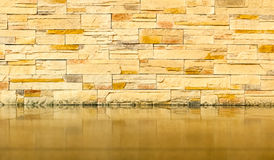 Brick wall with tiled floor Stock Photo