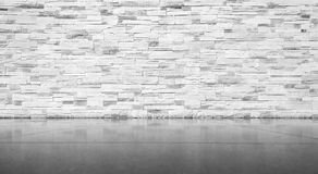 Brick wall with tiled floor Stock Images