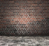 Brick wall and tiled pavement. Grunge background composed of red brick wall and beige and gray tiled area next to it Stock Image